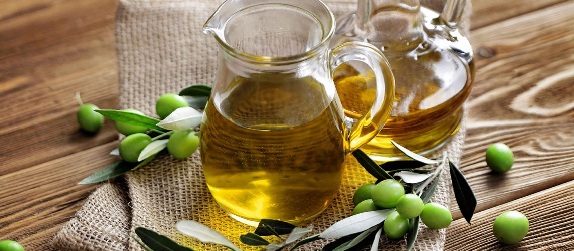 bigstock-bottles-of-olive-oil-with-oliv-299895790_2